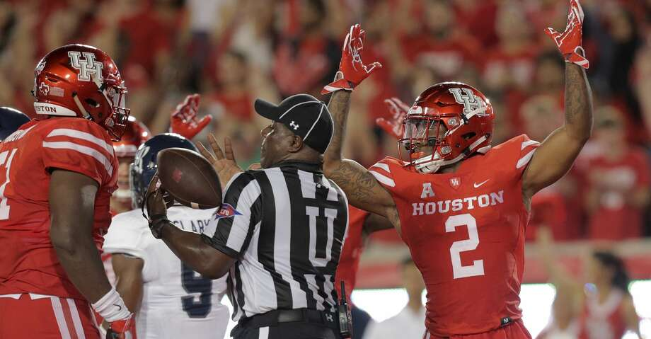 Houston Cougars running back Duke Catalon (2) celebrates his touchdown against Rice Owls  at TDECU Stadium on Saturday, Sept. 16, 2017, in Houston. ( Elizabeth Conley / Houston Chronicle ) Photo: Elizabeth Conley/Houston Chronicle