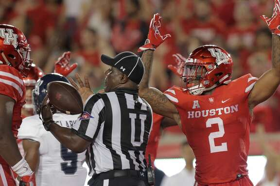 Houston Cougars running back Duke Catalon (2) celebrates his touchdown against Rice Owls  at TDECU Stadium on Saturday, Sept. 16, 2017, in Houston. ( Elizabeth Conley / Houston Chronicle )