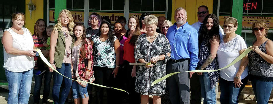 Renee Isbell cuts the ribbon tocommemorate her business, Lucky Star Cleanersmoving to a new location on Sept. 14. Lucky Star Cleaners is a member ofthe Coldspring/San Jacinto County Chamber of Commerce. Photo: Submitted