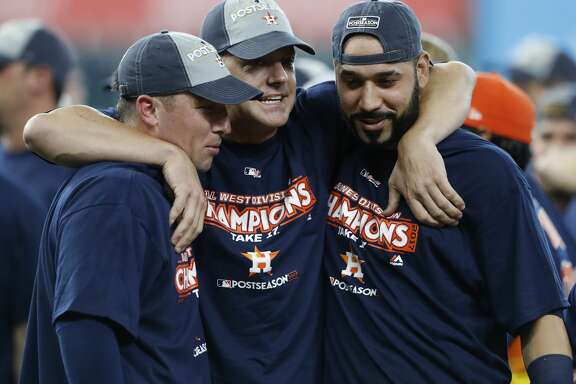 Houston Astros manager A.J. Hinch, center celebrates with Alex Bregman (2), and Marwin Gonzalez after they clinched the American League West crown after beating the Seattle Mariners 7-1 during an MLB baseball game at Minute Maid Park, Sunday, Sept. 17, 2017, in Houston.  ( Karen Warren / Houston Chronicle )