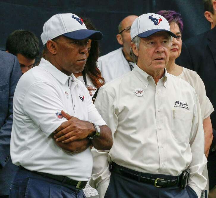 HOUSTON, TX - SEPTEMBER 10:  Houston mayor Sylvester Turner (L) and Harris County Judge Ed Emmett watch from the sidelines before the Houston Texans played the Jacksonville Jaguars at NRG Stadium on September 10, 2017 in Houston, Texas.  (Photo by Bob Levey/Getty Images)