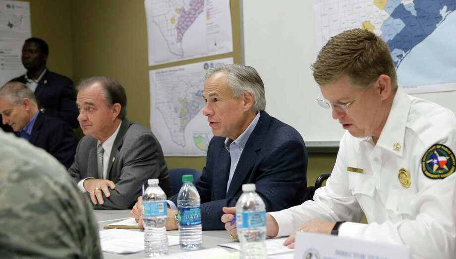 Texas Gov. Greg Abbott, center, and Commissioner John Sharp, seated second from left, receive a briefing on Hurricane Harvey recovery efforts at the new FEMA Joint Field Office, Thursday, Sept. 14, 2017, in Austin, Texas. (AP Photo/Eric Gay) Photo: Eric Gay, STF / Copyright 2017 The Associated Press. All rights reserved.