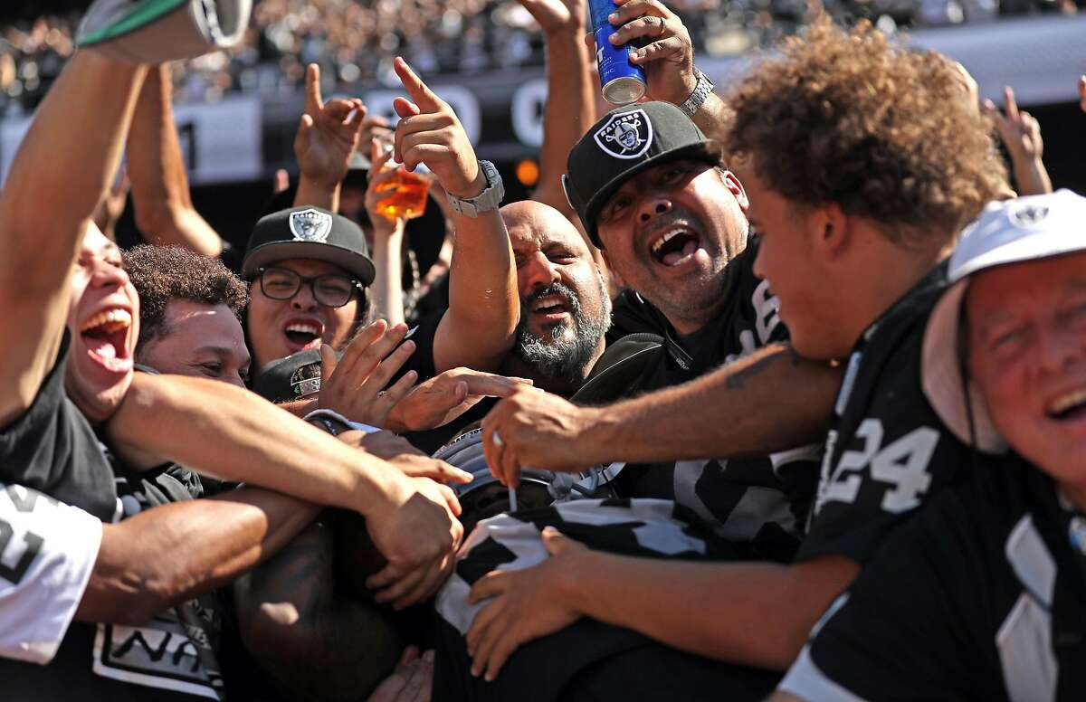 Oakland Raiders' Cordarrelle Patterson celebrates with fans after he scored on a 43-yard run in 3rd quarter against New York Jets during Raiders' 45-20 win in NFL game at Oakland Coliseum in Oakland, Calif., on Sunday, September 17, 2017.