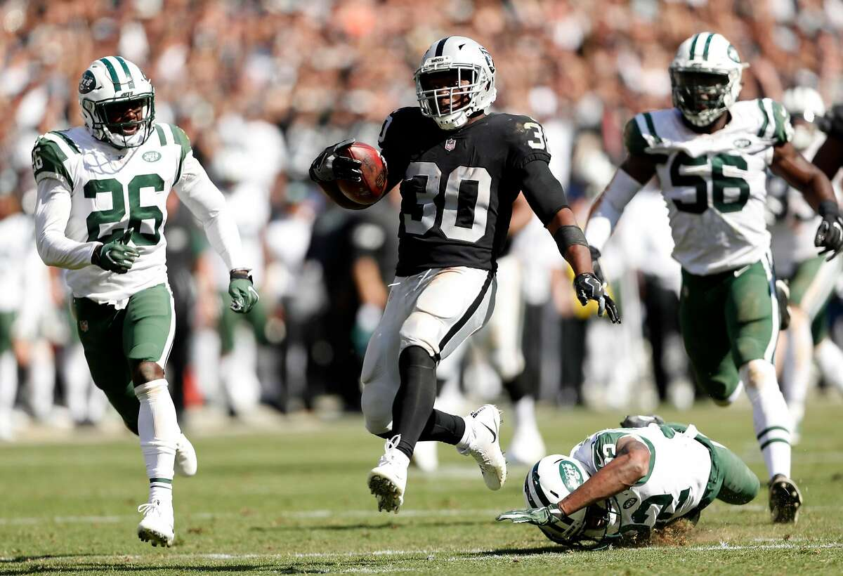 Oakland Raiders' Jalen Richard scores on a 52-yard run in 4th quarter against New York Jets during Raiders' 45-20 win in NFL game at Oakland Coliseum in Oakland, Calif., on Sunday, September 17, 2017.