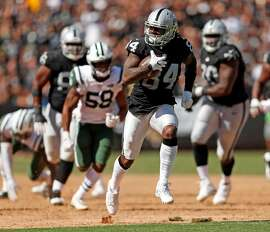 Oakland Raiders' Cordarrelle Patterson scores on a 43-yard run in 3rd quarter against New York Jets during Raiders' 45-20 win in NFL game at Oakland Coliseum in Oakland, Calif., on Sunday, September 17, 2017.