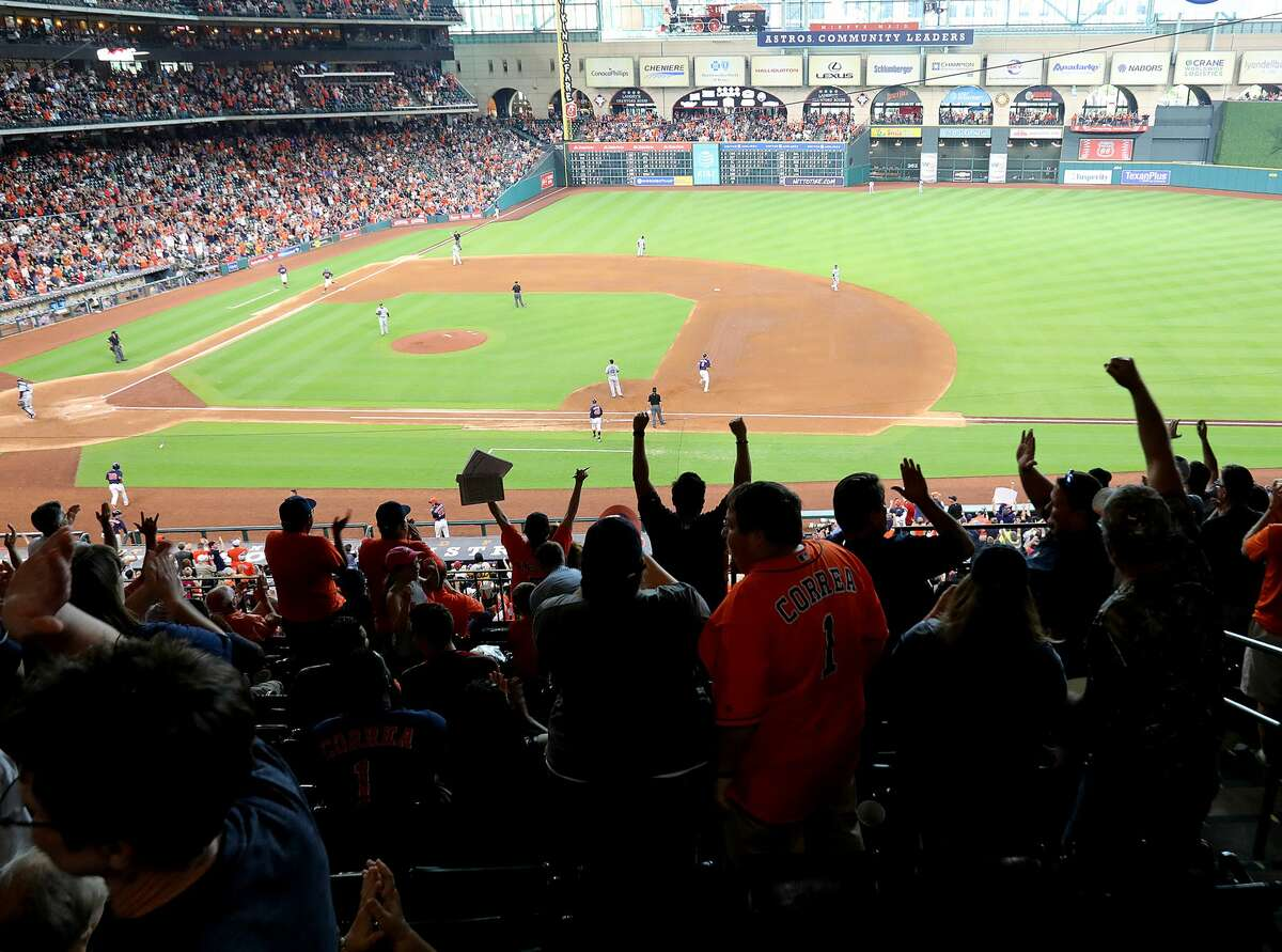 Fans cheer after a two-run home run by Houston Astros left fielder Derek Fisher (21) in the fifth inning. Photos of Houston Astros clinching the American League West conference by beating Seattle Mariners 7-1 at Minute Maid Park on Sunday, Sept. 17, 2017, in Houston. ( Elizabeth Conley / Houston Chronicle )