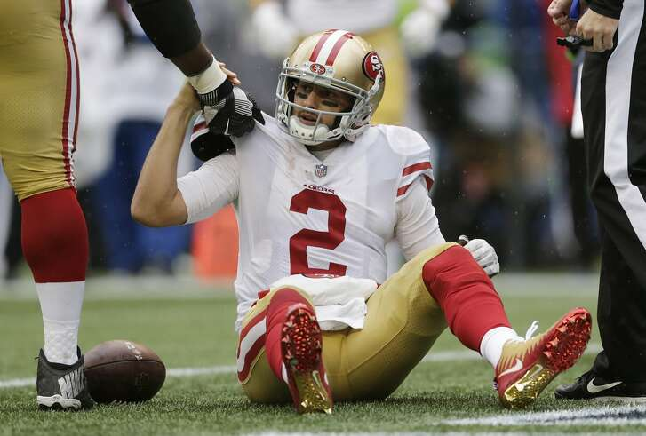 San Francisco 49ers quarterback Brian Hoyer is helped up after he was sacked in the second half of an NFL football game against the Seattle Seahawks, Sunday, Sept. 17, 2017, in Seattle. (AP Photo/John Froschauer)