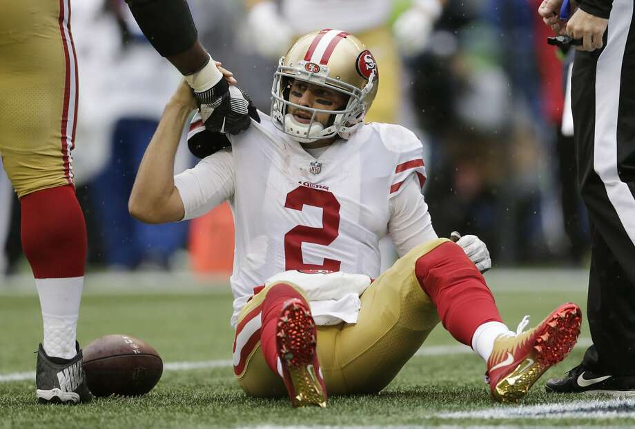 San Francisco 49ers quarterback Brian Hoyer is helped up after he was sacked in the second half of an NFL football game against the Seattle Seahawks, Sunday, Sept. 17, 2017, in Seattle. (AP Photo/John Froschauer) Photo: John Froschauer, Associated Press