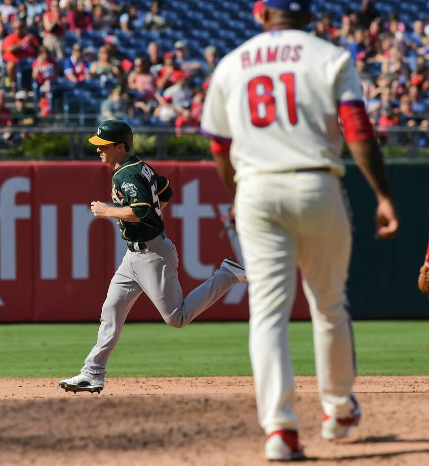 Oakland Athletics second baseman Joey Wendle rounds the bases after hitting a grand slam off Philadelphia Phillies reliever Edubray Ramos (foreground) in the sixth inning on Sunday, Sept. 17, 2017 at Citizens Bank Park in Philadelphia, Pa. The grand slam provided the winning runs as the A's beat the Phillies 6-3. (Clem Murray/Philadelphia Inquirer/TNS) Photo: Clem Murray, TNS