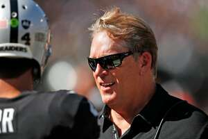 Oakland Raiders' head coach Jack Del Rio talks with Derek Carr in 3rd quarter of Raiders' 45-20 win over New York Jets in NFL game at Oakland Coliseum in Oakland, Calif., on Sunday, September 17, 2017.