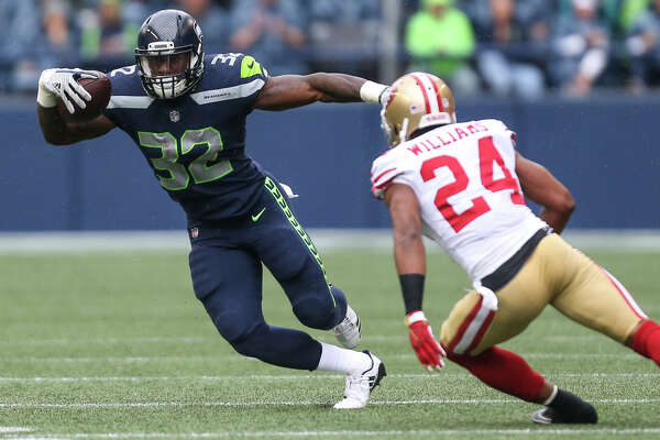 Seahawks running back Chris Carson jukes around 49ers corner back K'Waun Williams in the first half at CenturyLink Field on Sunday, Sept. 17, 2017.