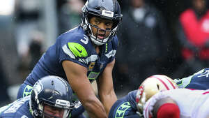 Seahawks quarterback Russell Wilson readies for the snap in the first half against the San Francisco 49ers at CenturyLink Field on Sunday, Sept. 17, 2017.