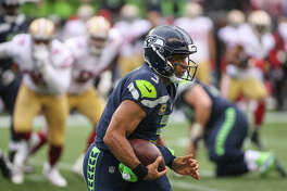 Seahawks quarterback Russell Wilson runs the ball in the quarter against the San Francisco 49ers at CenturyLink Field on Sunday, Sept. 17, 2017.