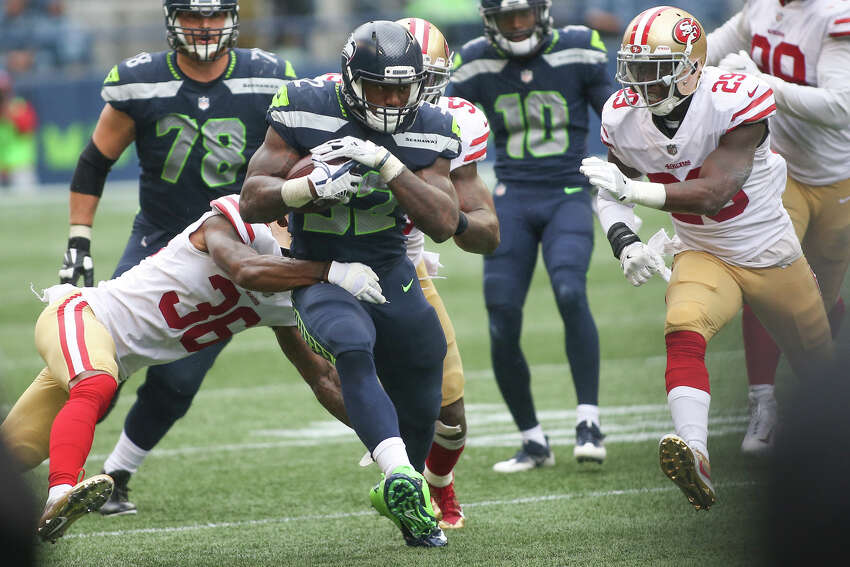 Seahawks running back Chris Carson seals his team's win with a 16-yard run for first down with two minutes left to go in the fourth quarter against the San Francisco 49ers at CenturyLink Field on Sunday, Sept. 17, 2017.