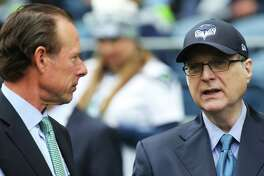 Seahawks owner Paul Allen, right, and president Peter McLoughlin talk on the sidelines before Seattle's game against San Francisco, Sunday, Sept. 17, 2017.