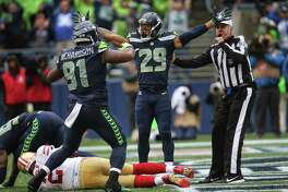 Seahawks safety Earl Thomas and defensive lineman Sheldon Richardson celebrate after Seahawks defensive lineman Frank Clark sacked 49ers quarterback Brian Hoyer on the 49ers 1-yard line  during the second half of Seattle's game against San Francisco, Sunday, Sept. 17, 2017.