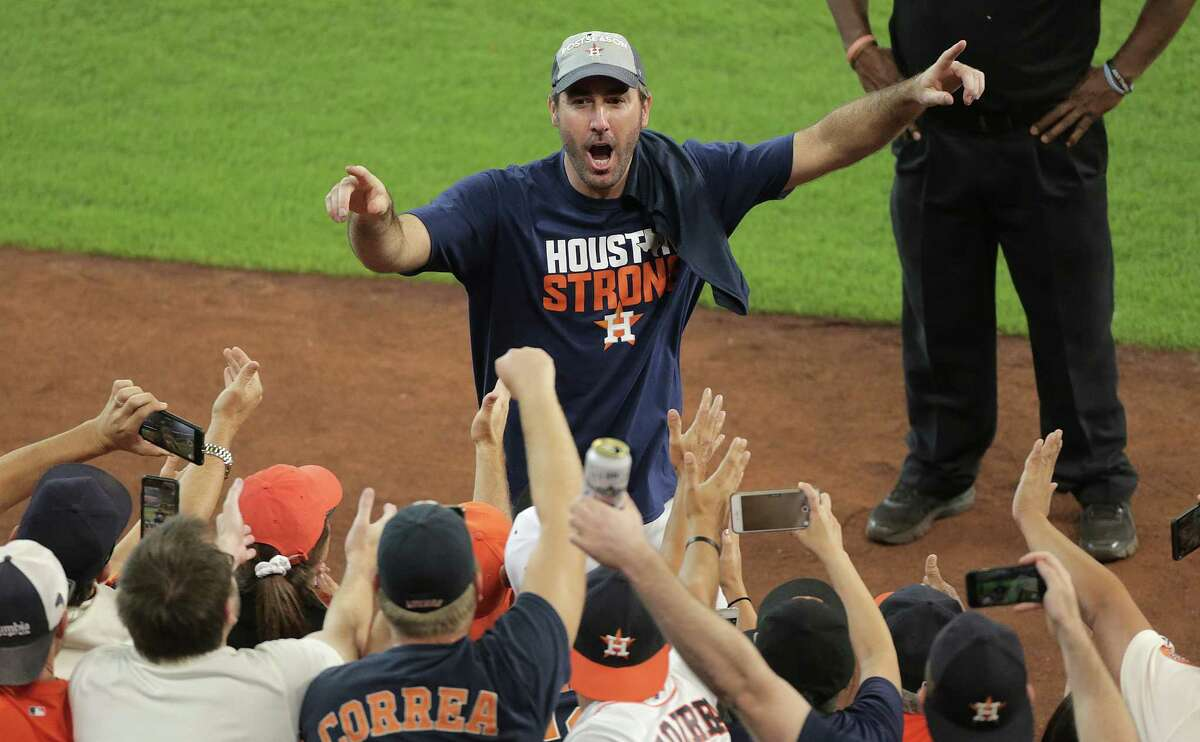 Astros starting pitcher Justin Verlander, middle, has won all three appearances with his new club since being acquired from Detroit, with none bigger than his AL-West clinching win Sunday.