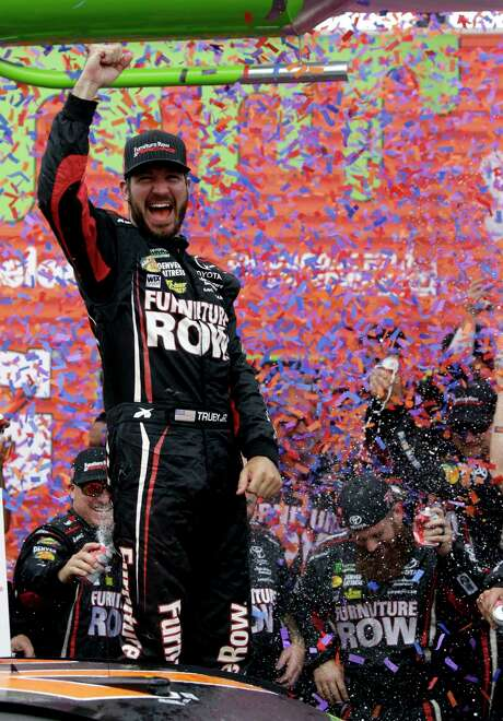 Martin Truex Jr. celebrates with his crew in Victory Lane after winning a NASCAR Cup Monster Energy Series auto race at Chicagoland Speedway in Joliet, Ill., Sunday, Sept. 17, 2017. (AP Photo/Nam Y. Huh) Photo: Nam Y. Huh, STF / Copyright 2017 The Associated Press. All rights reserved.
