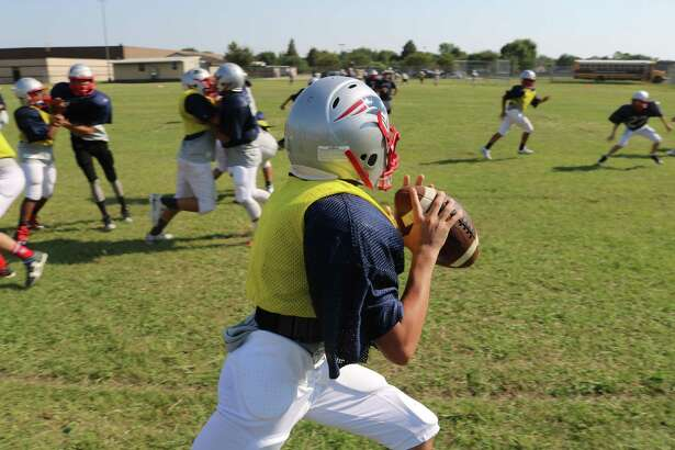 Bondy Intermediate School quarterback Kanye Ortiz looks for a receiver during Tuesday's practice. He and the hundreds of others from the intermediate school ranks are counting down the days to Sept. 25, the new opening day.