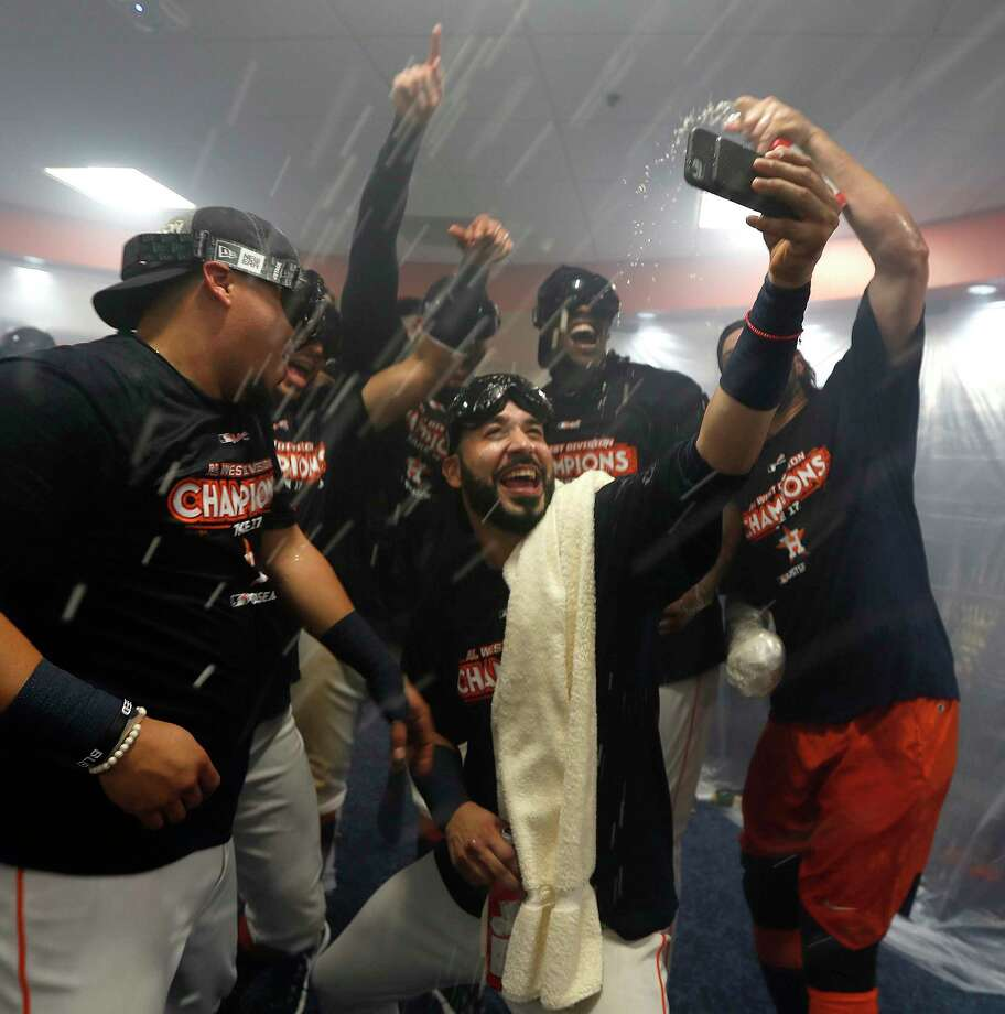 Marwin Gonzalez, center, takes a selfie with teammates amid streams of beer and Champagne on Sunday as the Astros celebrate clinching the AL West title. Photo: Karen Warren, Staff / @ 2017 Houston Chronicle