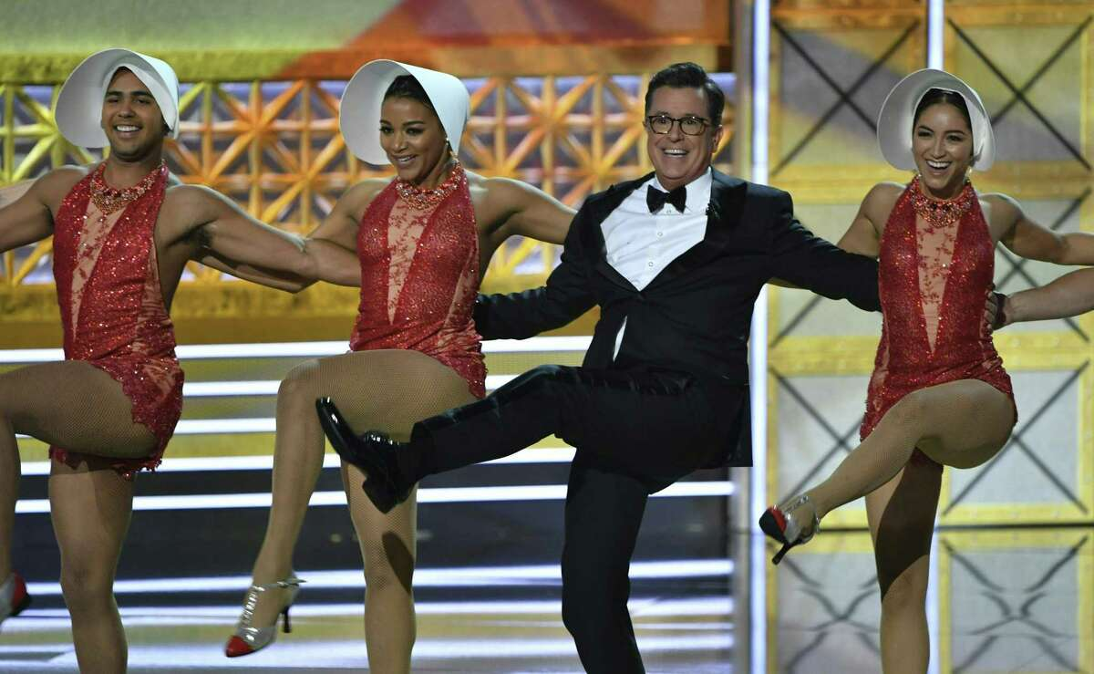 Host Stephen Colbert dances onstage during the 69th Emmy Awards at the Microsoft Theatre on September 17, 2017 in Los Angeles, California. / AFP PHOTO / Frederic J. BrownFREDERIC J. BROWN/AFP/Getty Images