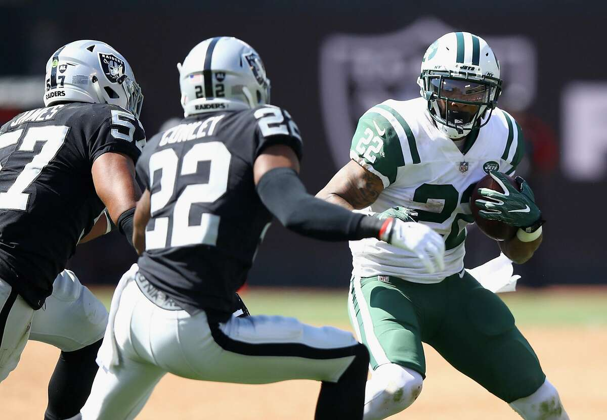 OAKLAND, CA - SEPTEMBER 17: Matt Forte #22 of the New York Jets tries to get away from Gareon Conley #22 and Cory James #57 of the Oakland Raiders at Oakland-Alameda County Coliseum on September 17, 2017 in Oakland, California. (Photo by Ezra Shaw/Getty Images)