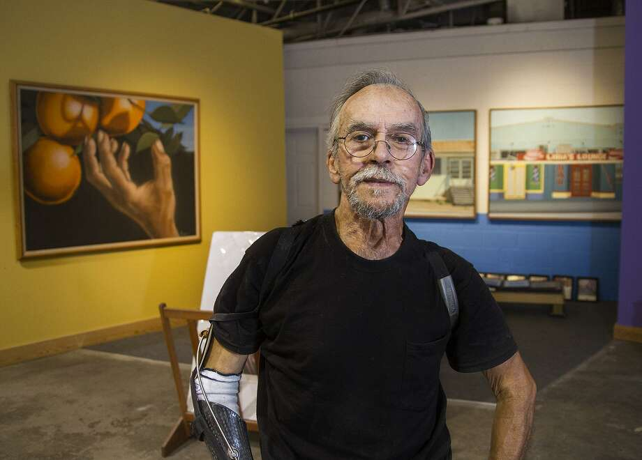 Artist Jesse Treviño poses for a photo in his studio. Though he has weathered serious health issues recently, Trevino is staying busy and planning new projects. Photo: Alma E. Hernandez /For The Express-News