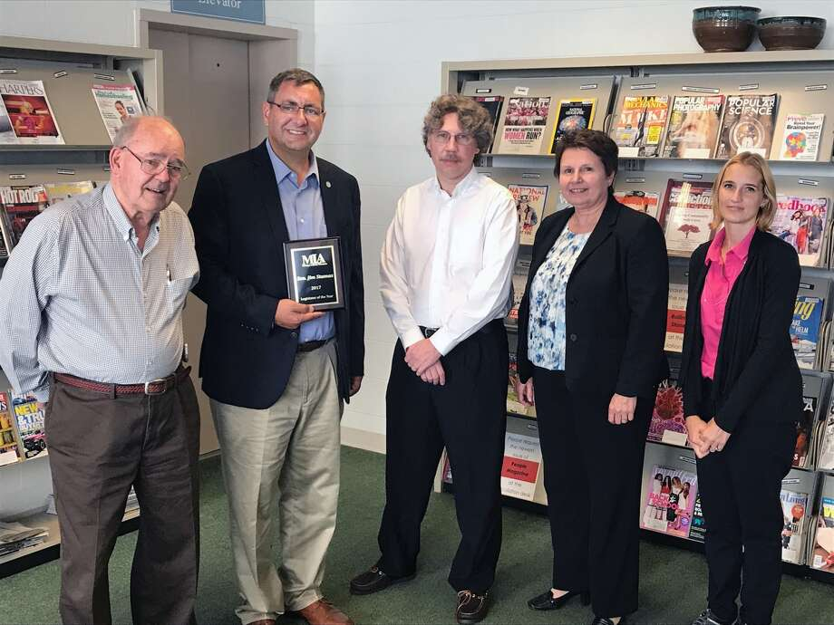 Sen. Jim Stamas, R-Midland, was honored as 2017 Legislator of the Year by the Michigan Library Association. Stamas was presented the award by MLA Executive Director Gail Madziar and Alpena County Library Director Eric Magness-Eubank in Alpena. Pictured from left, Ron Meneghel, treasurer of the Alpena County Library Board of Trustees; Stamas; Magness-Eubank; Madziar, and Tammy Thompson, secretary of the Alpena County Library Board of Trustees.