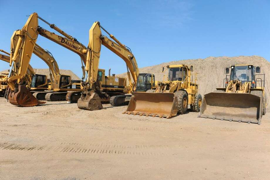 Earth moving equipment stands ready on an undeveloped section of the Steelpointe Harbor property in 2016. Photo: Ned Gerard / Hearst Connecticut Media / Connecticut Post