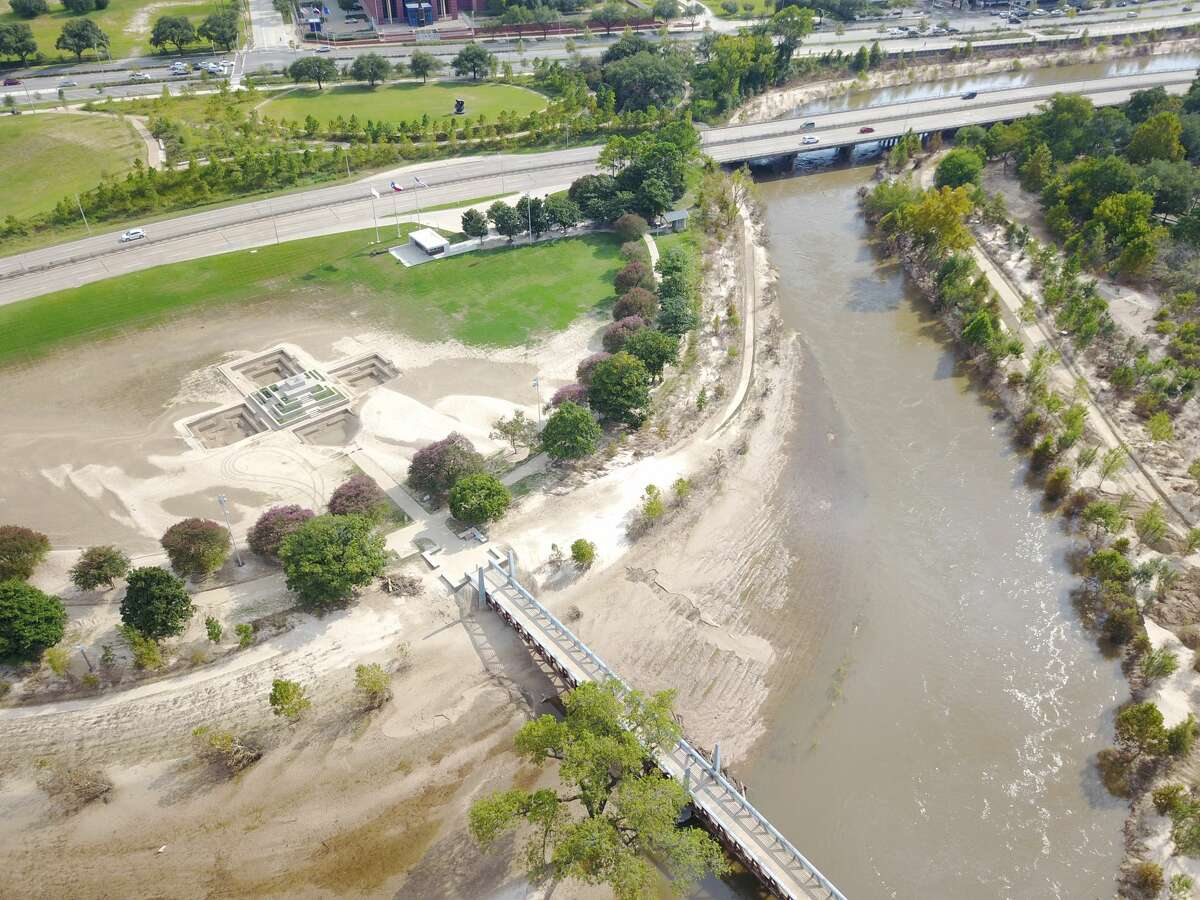 Jesus Bautista Moroles's Houston Police Officer Memorial on Buffalo Bayou is completely covered by sediment in this aerial photo from Friday, September 15, 2017.