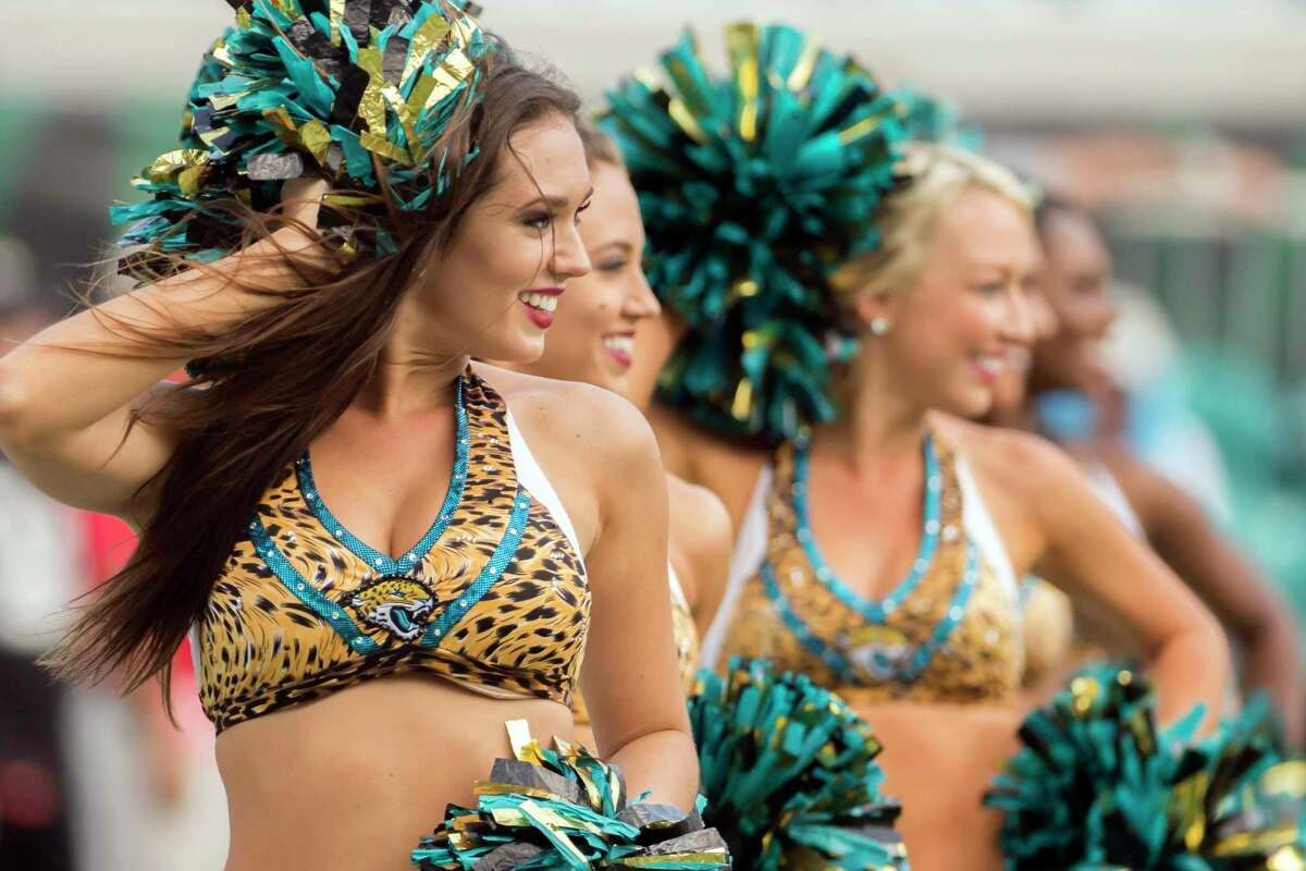 Members of the Jacksonville Jaguars Roar Cheerleaders perform during the second half of an NFL football game against the Tennessee Titans in Jacksonville, Fla., Sunday, Sept. 17, 2017. The Titans beat the Jaguars 37-16. (AP Photo/Stephen B. Morton)