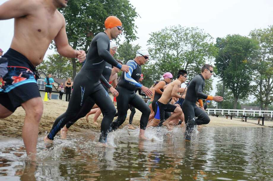 Athletes jump into the Long Island Sound to start the Domus NINER, a sextathalon fitness challenge to raise money to support Domus Kids, at Point72 in Stamford, Conn. on Sunday, Sept. 17, 2017. Participants, either as individuals or in a team, had to complete a 499-yard swim in Long Island Sound, 49 burpees, 199 lunges, 299 seconds of plank hold, 79 hand-release push-ups and a 0.99-mile run. Photo: Michael Cummo / Hearst Connecticut Media / Stamford Advocate