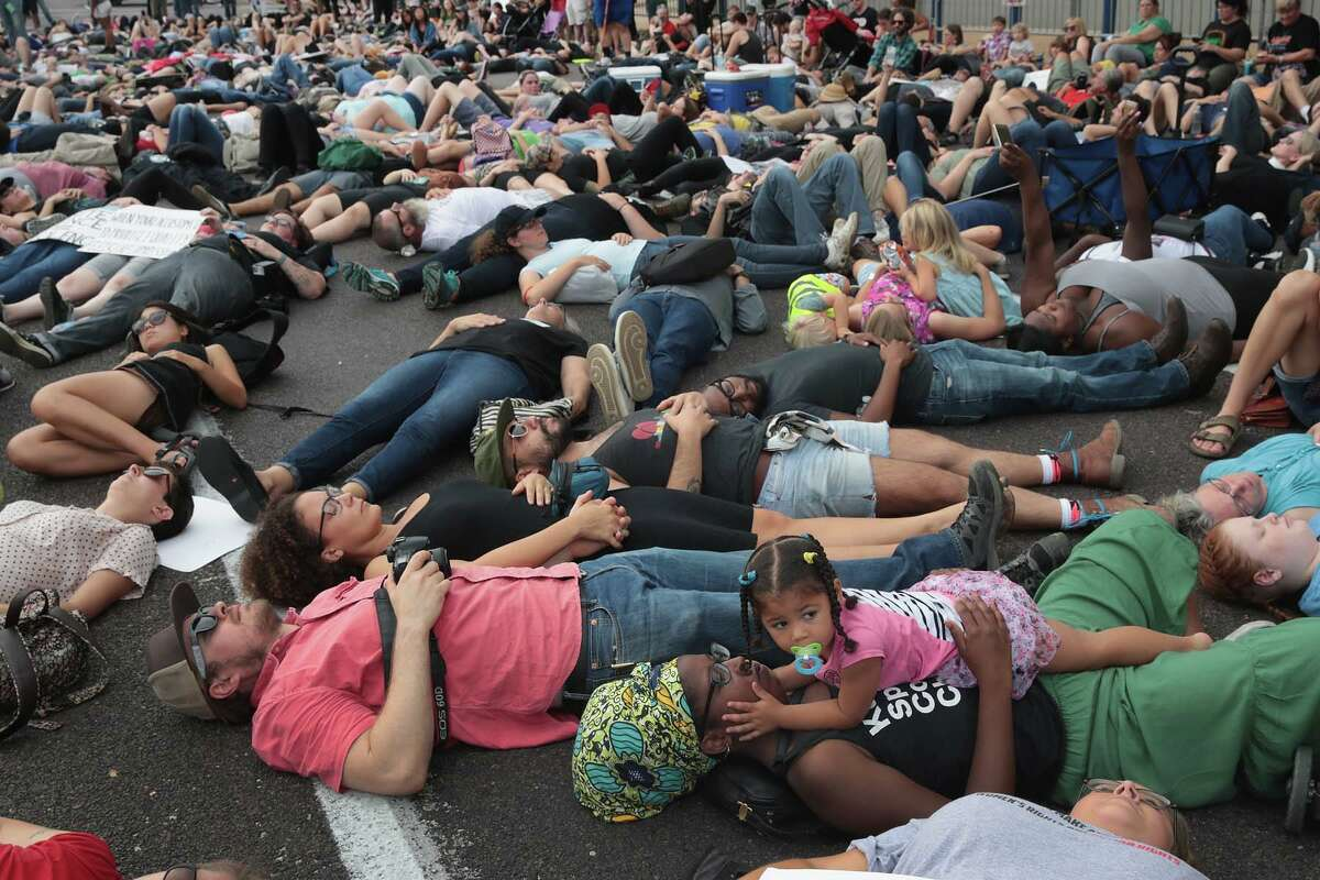 ST LOUIS, MO - SEPTEMBER 17: Demonstrators protesting the acquittal of former St. Louis police officer Jason Stockley stage a die-in in front of police headquarters on September 17, 2017 in St. Louis, Missouri. This is the third day of protests in the city following the acquittal of Stockley, who had been charged with first-degree murder last year following the 2011 on-duty shooting of Anthony Lamar Smith. (Photo by Scott Olson/Getty Images)