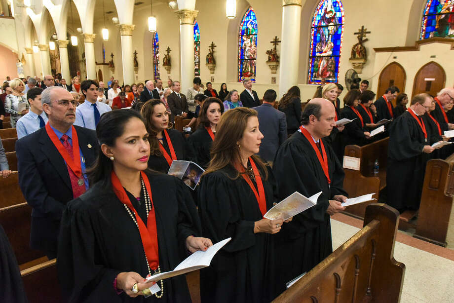 Judges Becky Palomo, Monica Notzon and Oscar J. Hale Jr., along with other judges, attorneys and government officials, participate in a Red Mass at San Agustin Cathedral on Tuesday evening. Photo: Danny Zaragoza/Laredo Morning Times