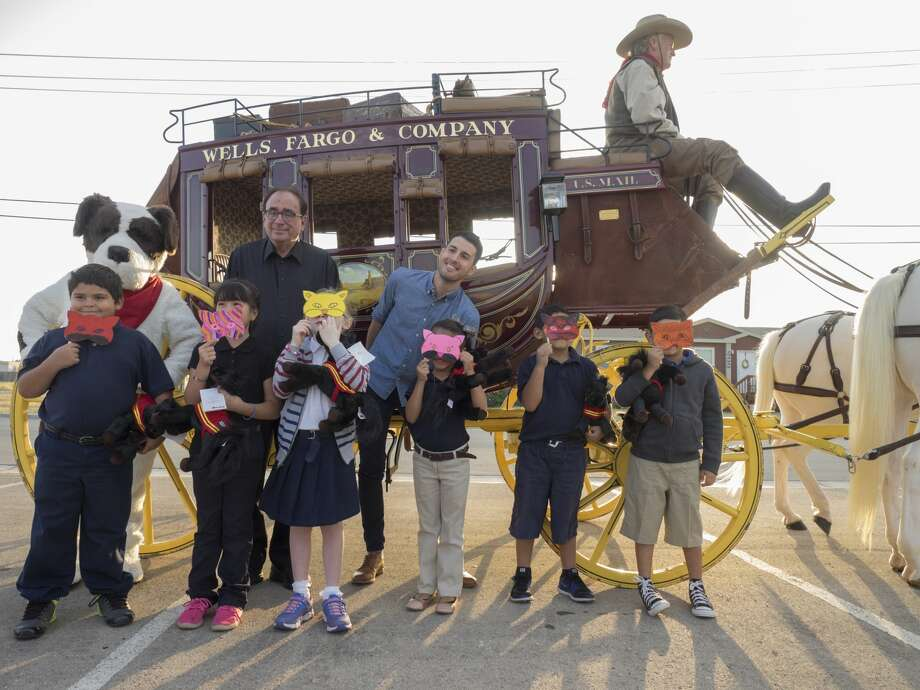 Author R.L. Stine and author Brendan Wenzel pose for pictures with first grade students from Travis Elementary 9/18/17 before they travel by Wells Fargo Stagecoach to the school to deliver books as part of Project Literacy.  Tim Fischer/Reporter-Telegram Photo: Tim Fischer/Midland Reporter-Telegram