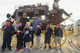 Author R.L. Stine and author Brendan Wenzel pose for pictures with first grade students from Travis Elementary 9/18/17 before they travel by Wells Fargo Stagecoach to the school to deliver books as part of Project Literacy.  Tim Fischer/Reporter-Telegram