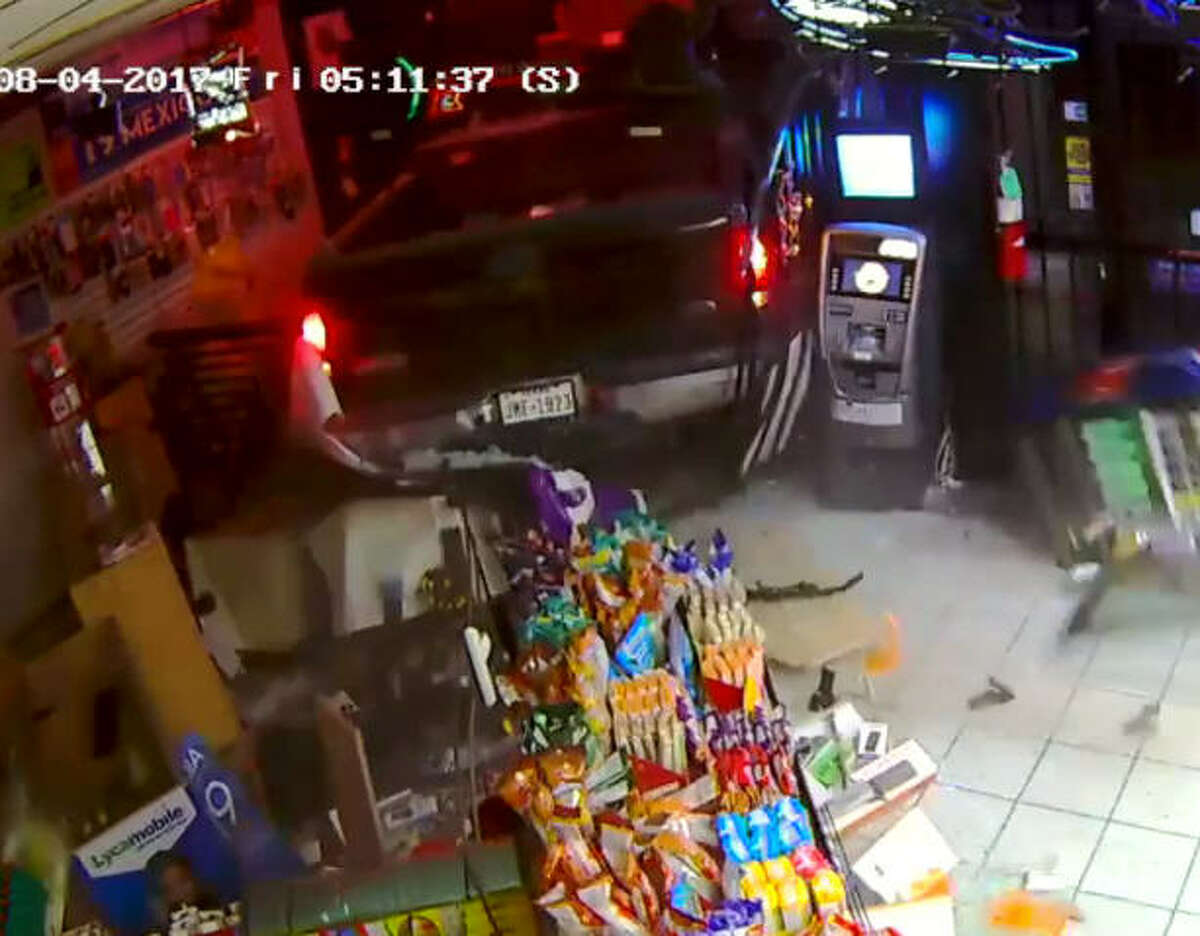 The Fort Bend County Sheriff's Office is searching for four male suspects who were recorded backing a truck into a Sugar Land store and stealing an ATM on Aug. 4, 2017.