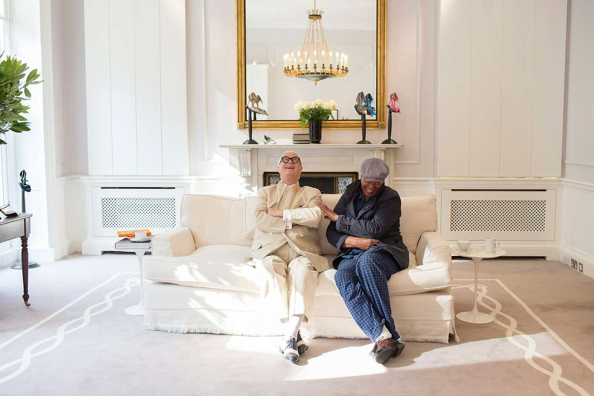 Manolo Blahnik, the shoe designer, left, and British fashion writer and artist Michael Roberts at Manolo Blahnik headquarters in London, Sept. 1, 2017. Roberts has directed a new documentary on the life of Blahnik, �Manolo: The Boy Who Made Shoes for Lizards.� (Lauren Fleishman/The New York Times)