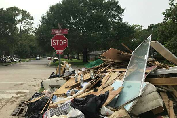 Residents of Bellaire neighborhoods are slowly getting back to normal despite mountains of debris strewn on laws throughout the community.