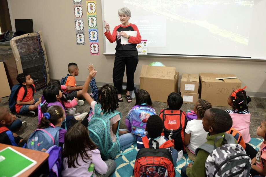First grade teacher Lisa Moeller and her class discuss the impact of Tropical Storm Harvey to their Ft. Bend ISD Seguin Elementary classroom at Richmond, TX, September 12, 2017. Photo: Craig Moseley, Staff / ©2017 Houston Chronicle