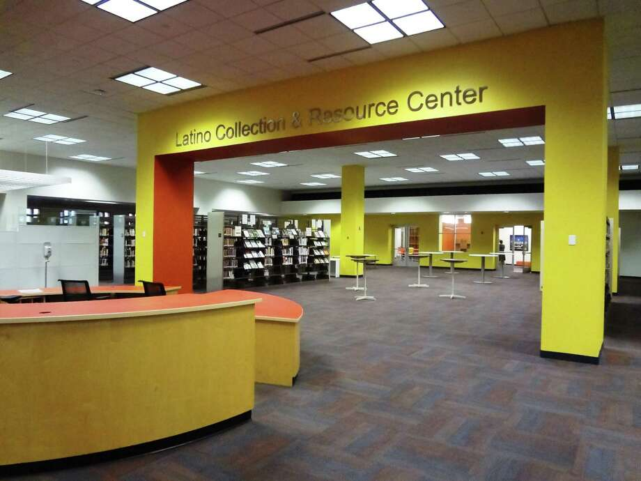 The San Antonio Public Library's Latino Collection & Resource Center, featuring 10,000 volumes, has been expanded and relocated to the first floor of the Central Library downtown. Photo: Steve Bennett / San Antonio Express-News