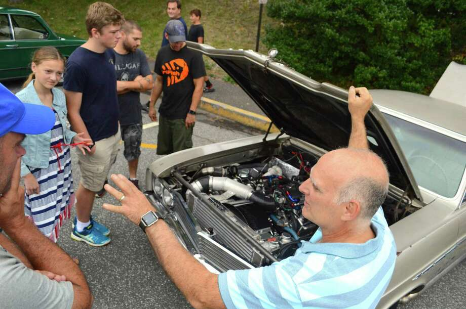 Albert Bonamici of Newtown talks about his 1965 Buick Skylark at the Caffeine & Carburetors auto show, Sunday, Sept. 17, 2017, in New Canaan, Conn. Photo: Jarret Liotta / For Hearst Connecticut Media / New Canaan News Freelance