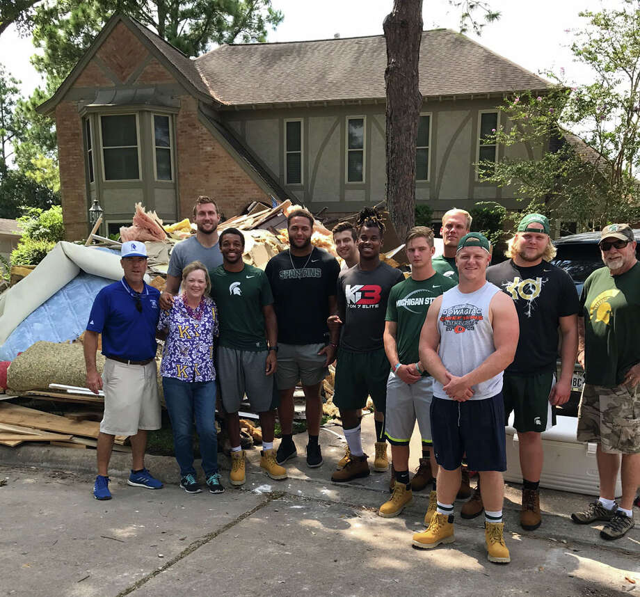 Episcopal coach Steve Leisz, left, and his wife had some unexpected assistance from Michigan to help with cleanup. Photo: Courtesy Photo