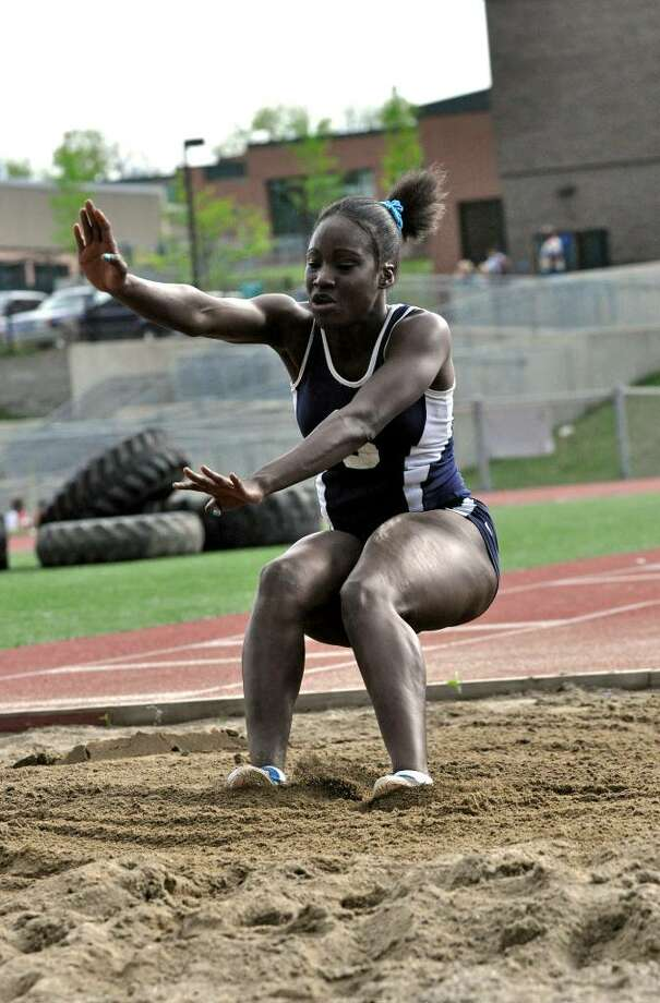 Staples' Joselyn Henry competes in the long jump against Danbury and Bridgeport Central on Tuesday, May 4, 2010. Photo: Amy Mortensen / Connecticut Post