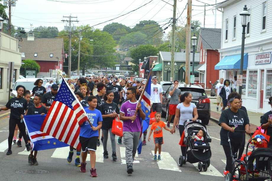 The crowd of more than 200 participants heads up Sanford Street at the second annual Walk Like MADD awareness event, held at Fairfield Theatre Company, Saturday, Sept. 16, 2017, in Fairfield, Conn. Photo: Jarret Liotta / For Hearst Connecticut Media / Fairfield Citizen News Freelance