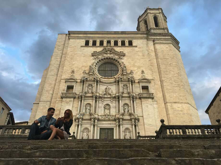 "A couple sits on the steps of Girona Cathedral, which was used in ""Game of Thrones"" as the cathedral in King's Landing. Photo: Mark Anderson, Special To The Chronicle"