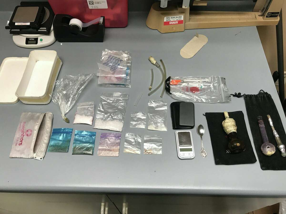 Items allegedly found under a vehicle passenger seat in Splendora on Sept. 17. Suspect Cody Wayne Barnhart was arrested and charged with possession of a controlled substance with intent to manufacture and deliver.