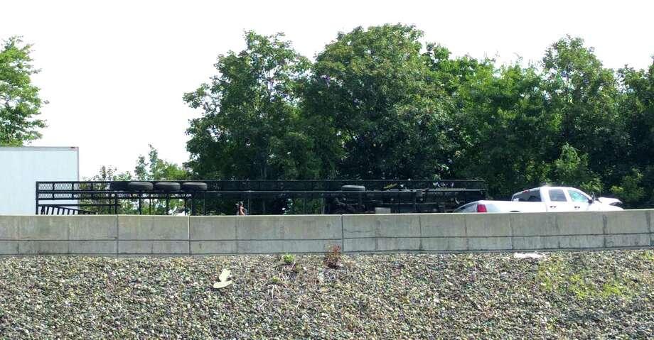 A fifth-wheel trailer lays overturned on an I-95 off-ramp. Bridgeport, Conn., Sept. 18, 2017 Photo: Cedar Attanasio / Hearst Connecticut Media / Connecticut Post