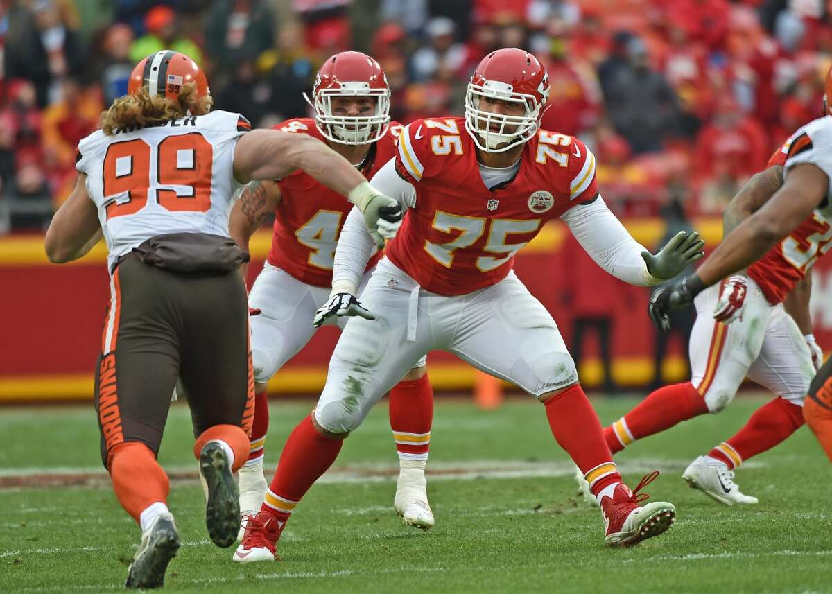 KANSAS CITY, MO - DECEMBER 27: Offensive tackle Jah Reid #75 of the Kansas City Chiefs gets set to block linebacker Paul Kruger #99 of the Cleveland Browns during the first half on December 27, 2015 at Arrowhead Stadium in Kansas City, Missouri. (Photo by Peter G. Aiken/Getty Images)