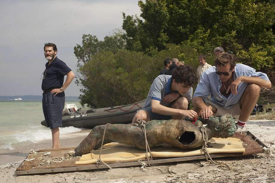 In Call Me by Your Name, teenager Elio (Timothee Chalamet, center) develops feelings for doctoral student Oliver (Armie Hammer), who works for Elio's father, Mr. Perlman (Michael Stuhlbarg, left).CAPTION CREDIT:Sony Pictures Classics Photo: Sony Pictures Classics